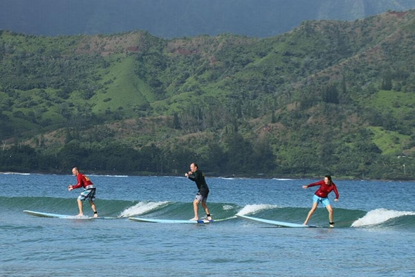 Family learning to surf