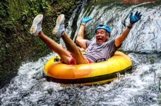 Grampa Enjoying Mountain Tubing
