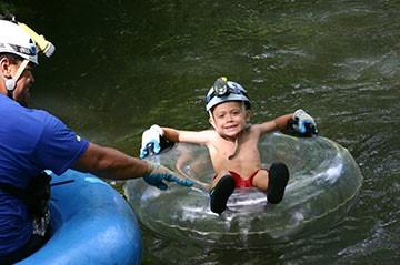 Little Kid On Kauai Mountain Tubing Adventure