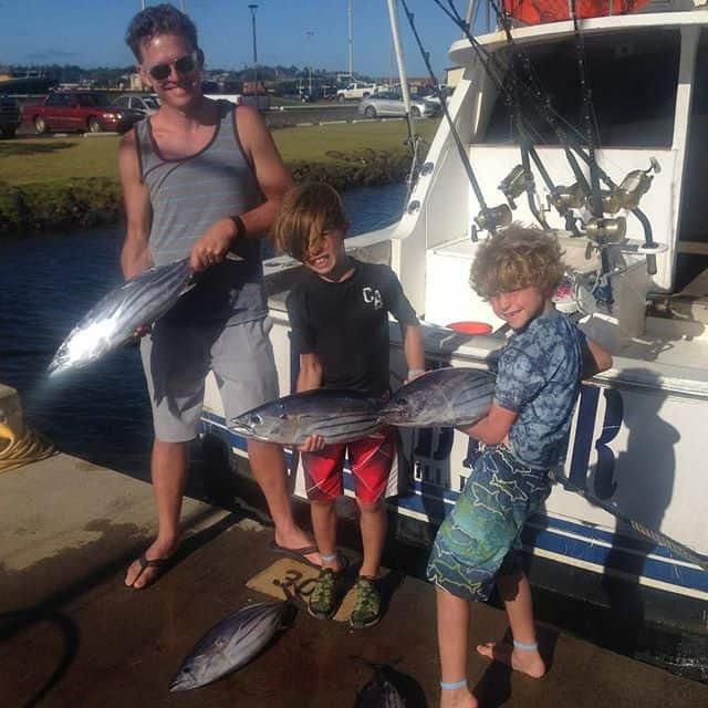 Father and sons with their fresh catches