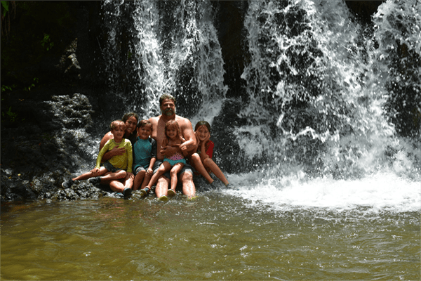 Kauai ATV Tours - Family taking a photo-opp at a waterfall