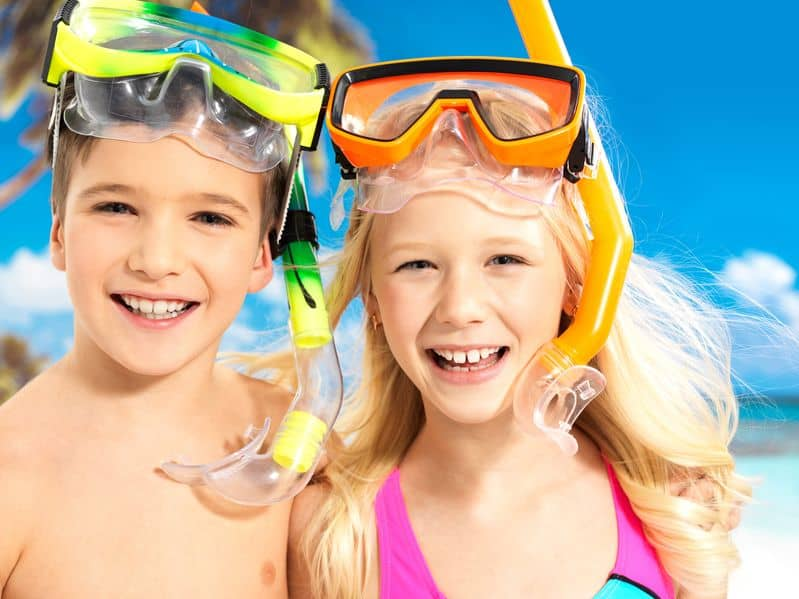Two kids with snorkeling gear from Kauai photography