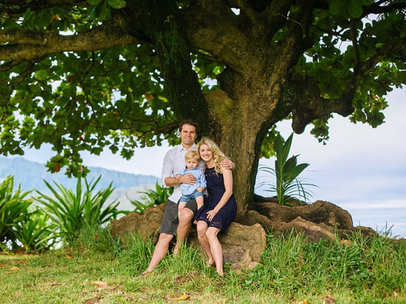 Kauai family photo by tree at bay