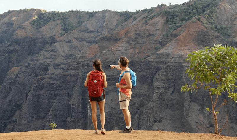 Couple hiking Waimea Canyon Kauai