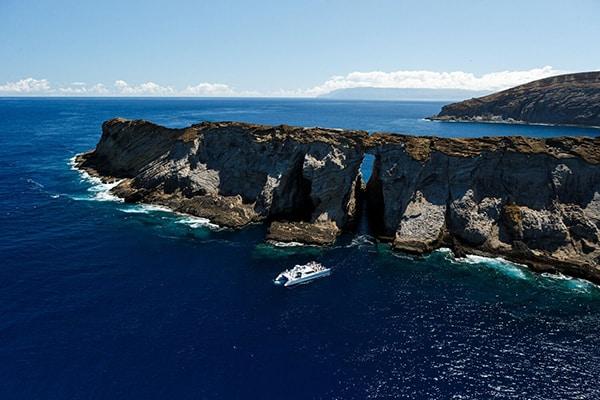 Niihau Boat Tour exploring rock formations
