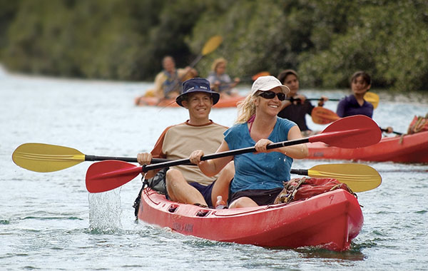 Couple kayaking on Kauai's Wailua River